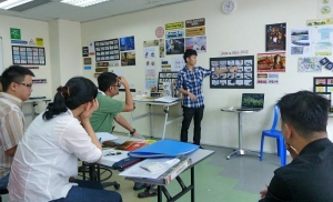 ALFA College design student giving his final semester project presentation