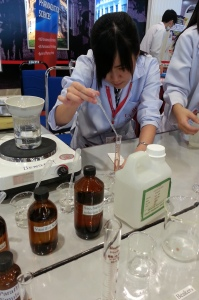 A UCSI University Pharmacy student giving a public demonstration about making medicines