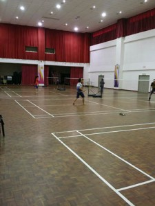 First City University College students playing badminton in the multi-purpose hall
